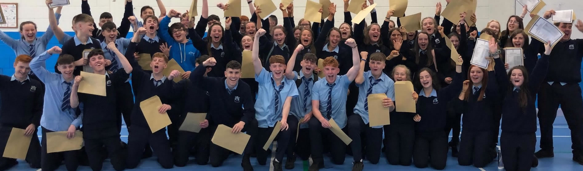 St Catherine's VS Pupils holding up exam results